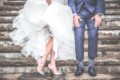 Woman and man on wedding day showing off their shoes